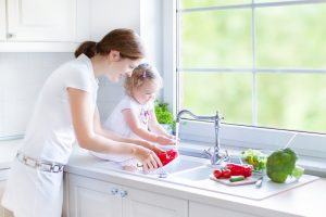 mother-and-daughter-by-kitchen-sink
