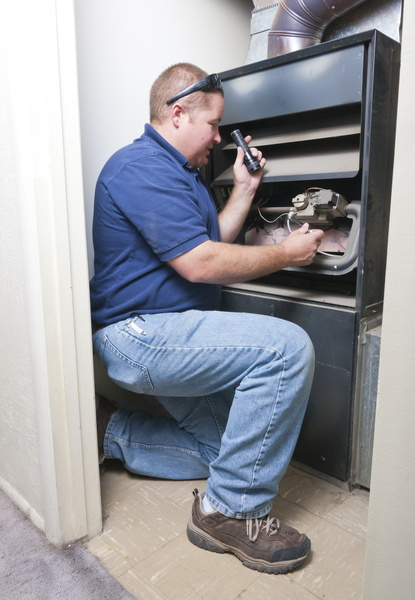 technician-servicing-furnace