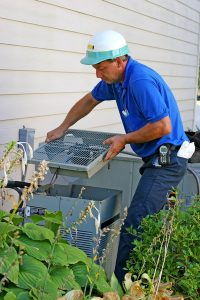 technician-working-with-outdoor-ac-unit