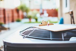 air-conditioning-outside-unit-with-clipboard-sitting-on-top