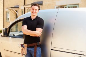 service-professional-standing-in-front-of-van