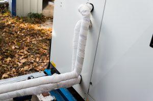 refrigerant-line-behind-air-conditioner