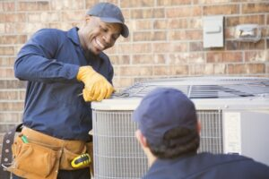 two-technicians-working-on-an-air-conditioner