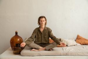 man-in-yoga-pose-enjoying-indoor-environment