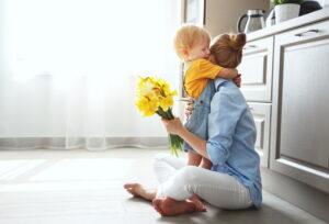 son-hugging-mom-on-kitchen-floor